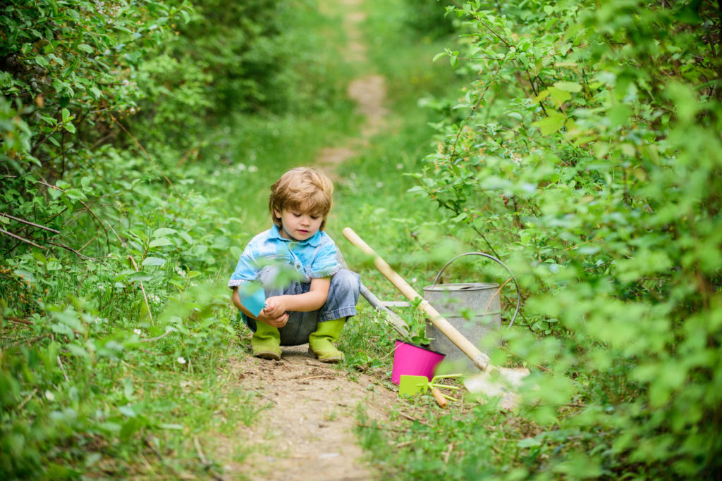 a child is learning to grow his own food
